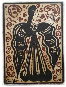 Socarrat Artesanía dama oliendo una flor