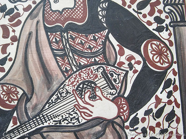 Socarrat músico laúd